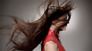 fashion model hair blowing in the wind profile