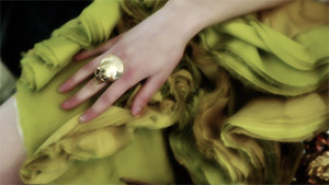 fashion models hand on yellow dress with skull ring