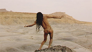 atsushi takenouchi on clif edge in loin cloth dancing