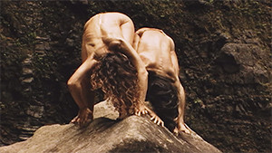 Kathi von Koerber and Atsushi Takenouchi bending down over rock