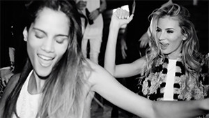 fashion models dancing and smiling