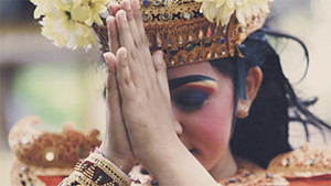 Balinese girl with traditional costume praying