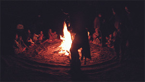 silhouette of tribal ritual by fire
